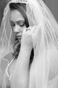 Bride Adjusts Her Vail