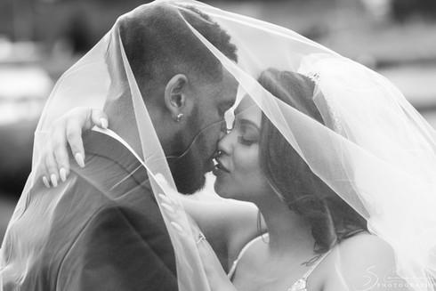 Bride & Groom Kiss Under Veil