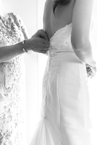 Grandmother Fastens the Bride's Dress
