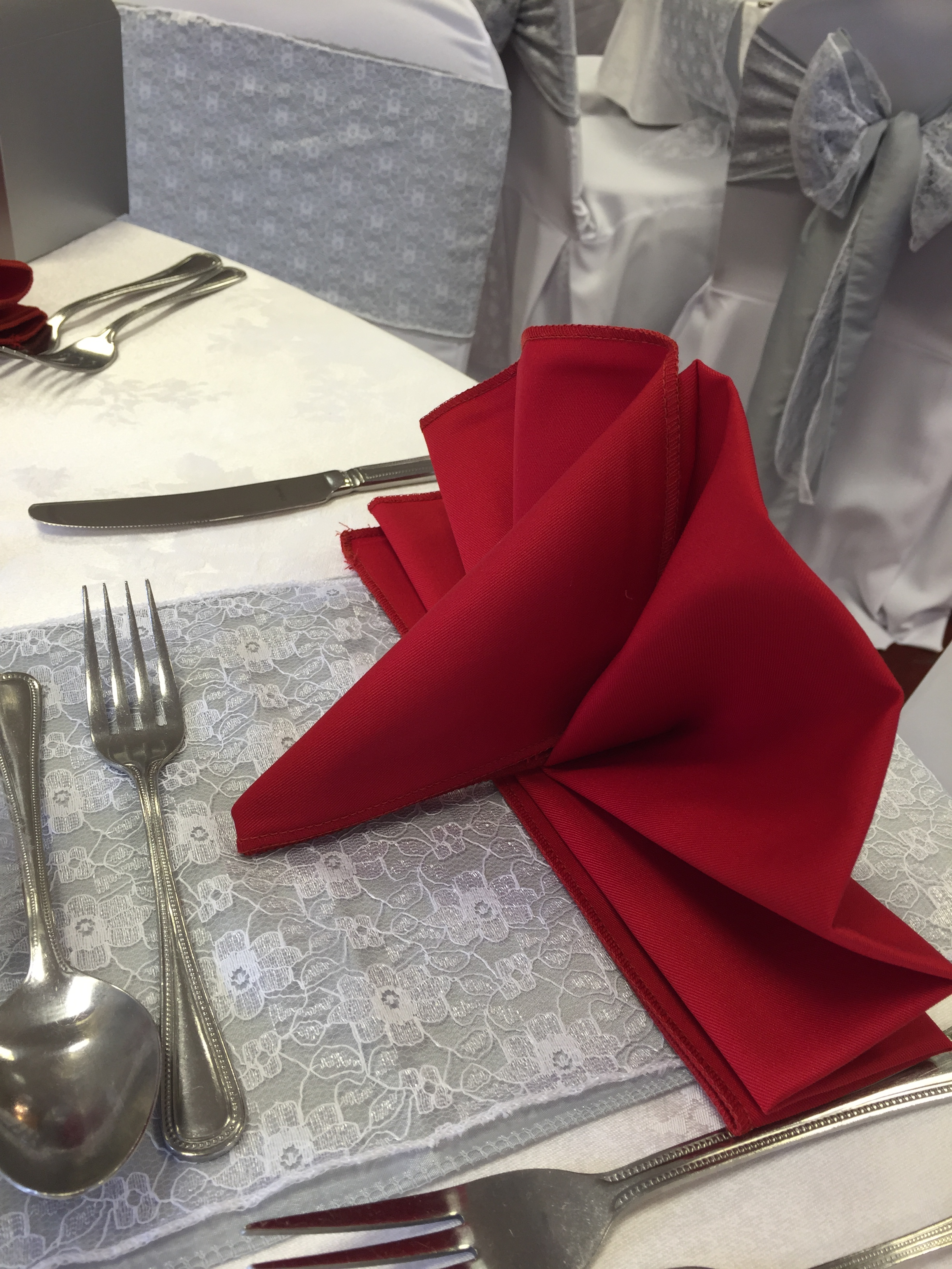 Fan style folded red linen napkin