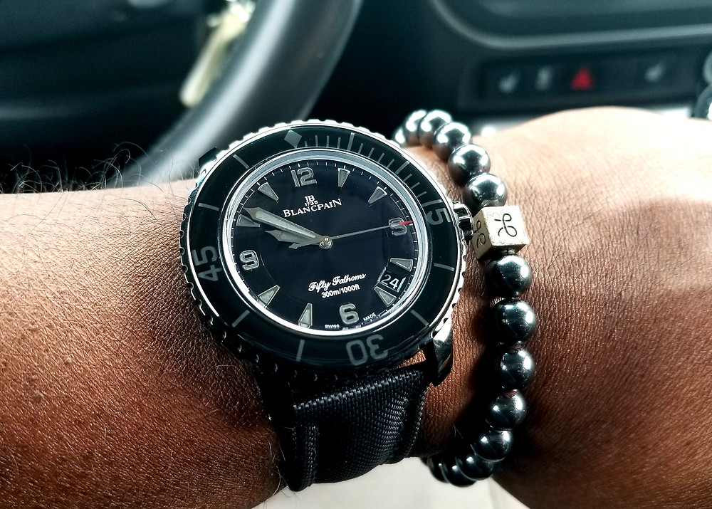 "WOTD Wrist-Shot of a Blancpain, Fifty Fathoms, ""Dark Knight"" dive watch, accompanied by an Aurum Brothers, minimalist hematite beaded bracelet."