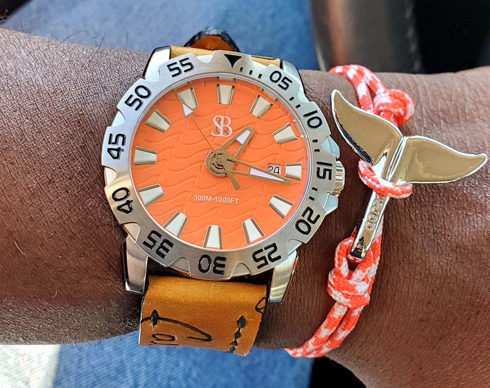 WOTD wrist-shot of the Smith and Bradley, Wraith Diver.  Paired with a Starburst, Whale Tail rope bracelet, designed by Dorsal Bracelet Company.