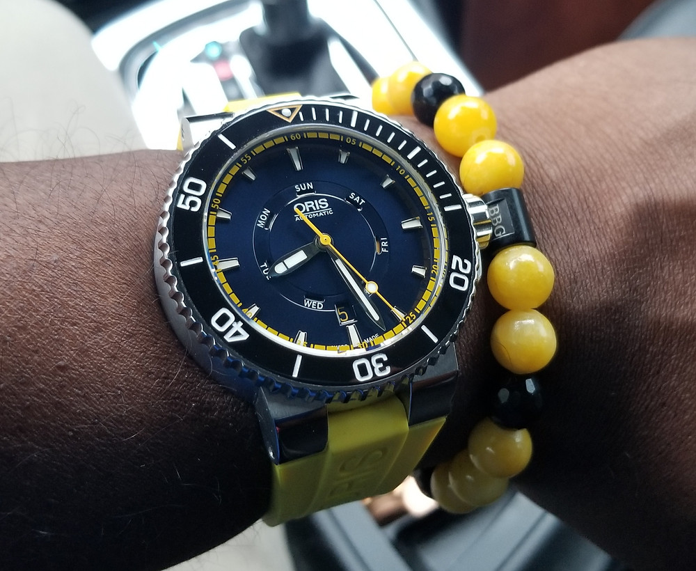 WOTD wrist shot of the Oris, Aquis, Great Barrier Reef Diver, accompanied by custom Beads By Gonzo beaded bracelet.