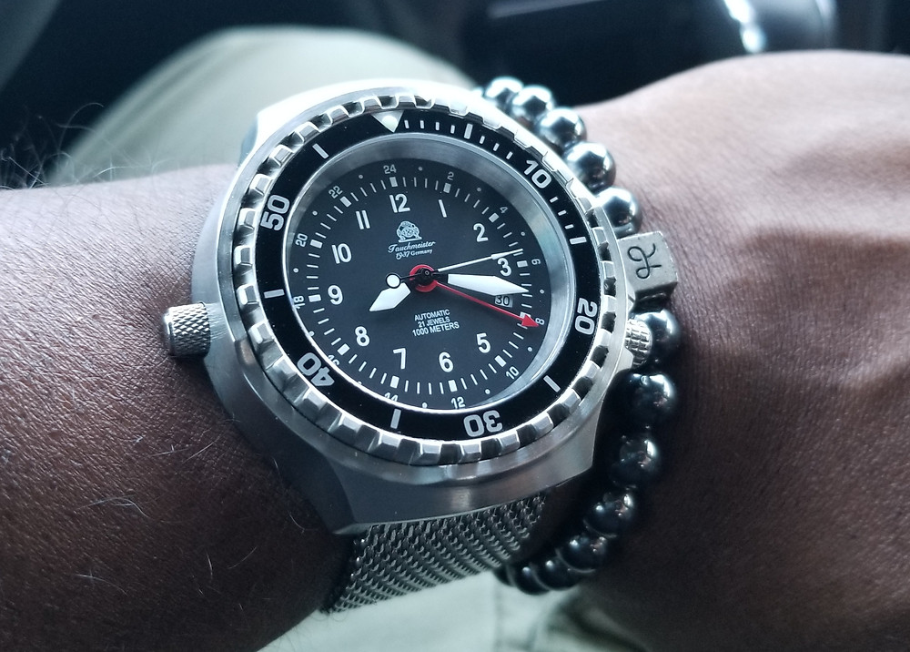 WOTD Wrist-Shot showing the Tauchmeister, 1,000 Meter Diver XL, accompanied by Aurum Brothers, Hematite, Beaded bracelet.