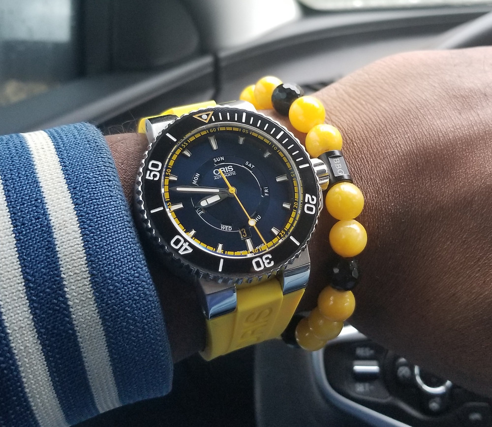 WOTD wrist-shot of the Oris, Aquis, Great Barrier Reef Diver, paired with a custom beaded bracelet designed by Beads By Gonzo.