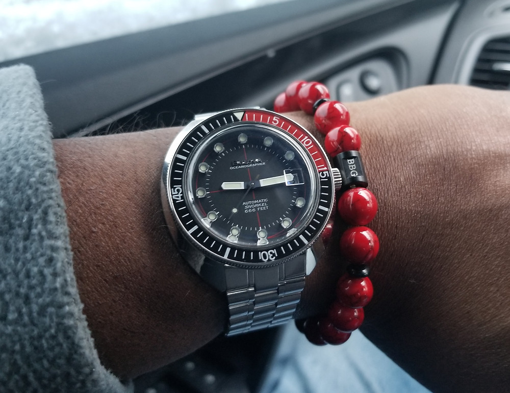 WOTD wrist-shot of Bulova, Oceanographer, Devil Diver 666, Re-Issue, paired with a custom bracelet designed by Beads By Gonzo.