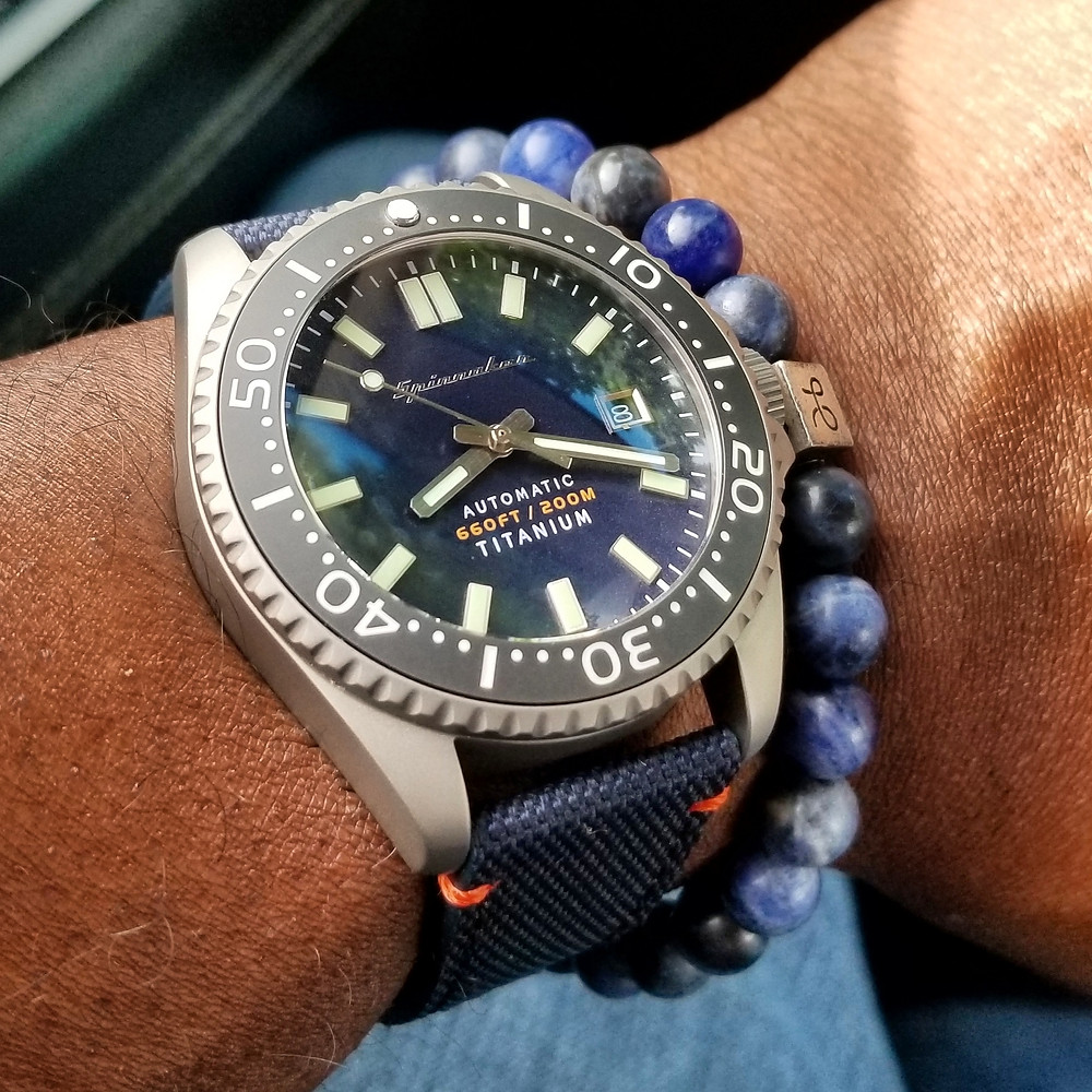 WOTD wrist-shot of the Spinnaker, Tesei - Titanium.  Paired with a minimalist, Sodalite stone bracelet, created by by Aurum Brothers.