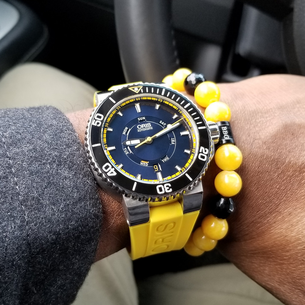WOTD wrist-shot of the Oris, Aquis, Great Barrier Reef Diver, Limited Edition, paired with a custom, beaded bracelet, designed by Beads By Gonzo.