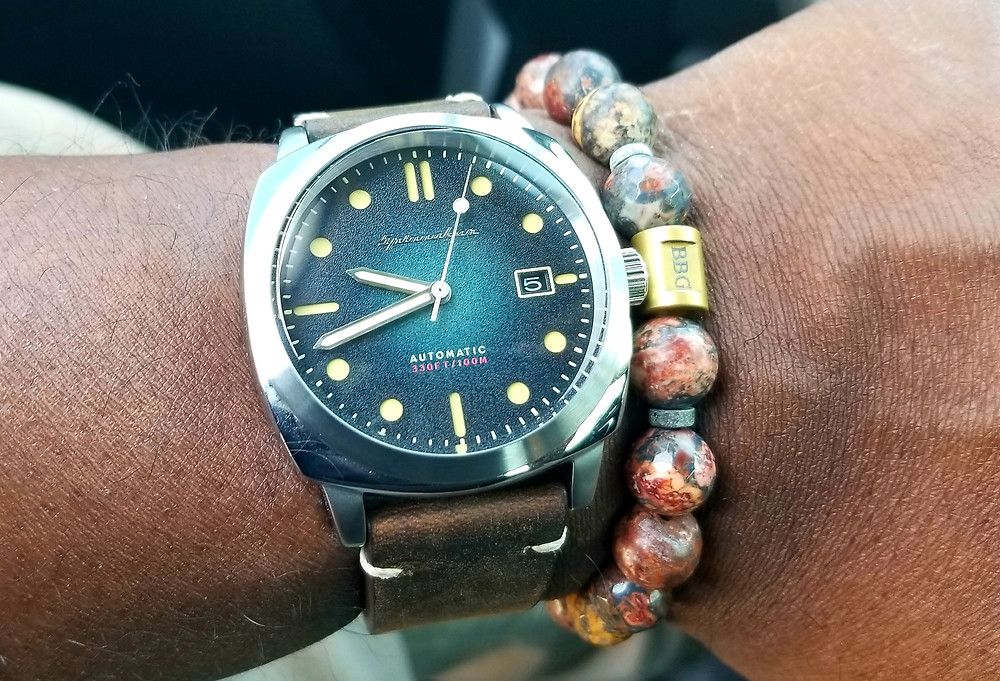 WOTD Wrist Shot showing the Spinnaker, Hull, Automatic, accompanied by custom-designed Beads by Gonzo beaded bracelet.