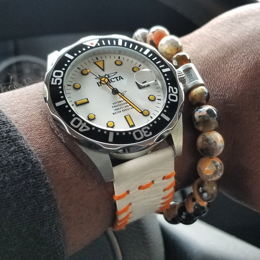 "WOTD wrist-shot of the Invicta, ""Creamsicle"" Grand Diver.  Paired with a custom-designed bracelet, created by Beads By Gonzo."