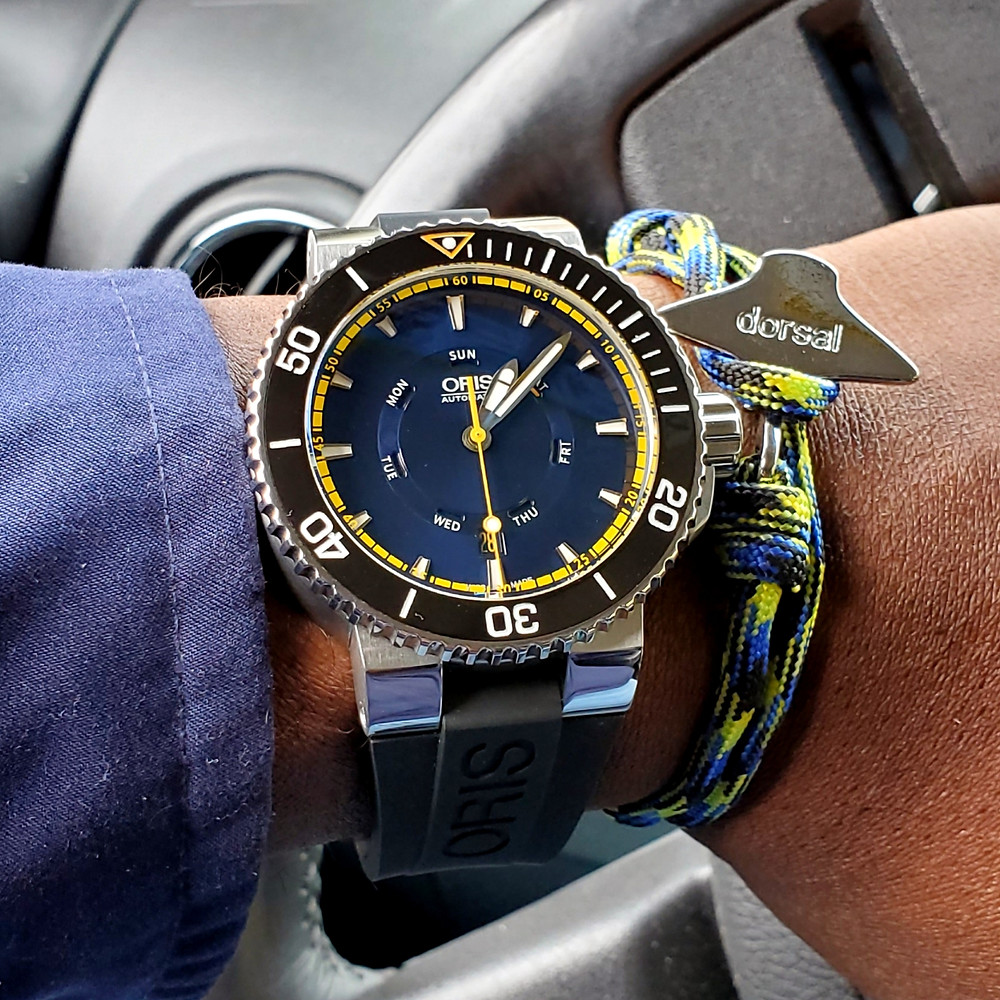 WOTD wrist-shot of the Oris, Aquis, Great Barrier Reef, Limited Edition II.  Paired with an Eagle Ray, rope bracelet, in color Peacock, designed by Dorsal Bracelet Company.