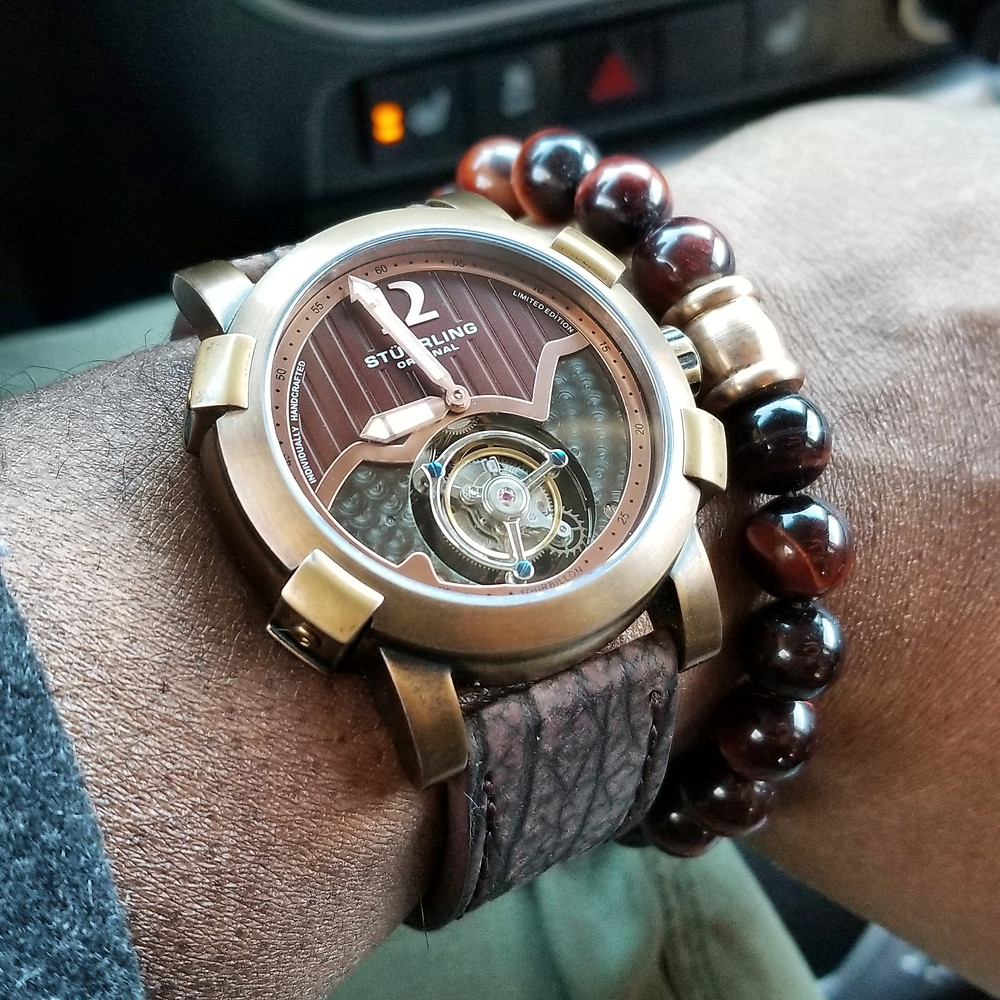WOTD wrist-shot of the Stuhrling Original, Devilray Tourbillon, Limited Editio, paired with a tiger's-eye, beaded bracelet.