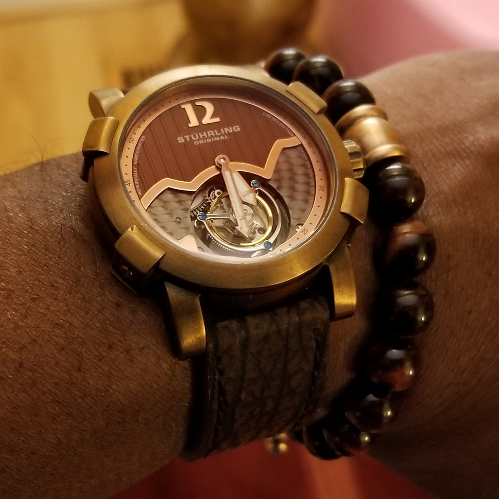 WOTD wrist-shot of the Stuhrling Original, Devilray Tourbillon, Limited Edition, paired with a tiger's-eye, beaded bracelet.