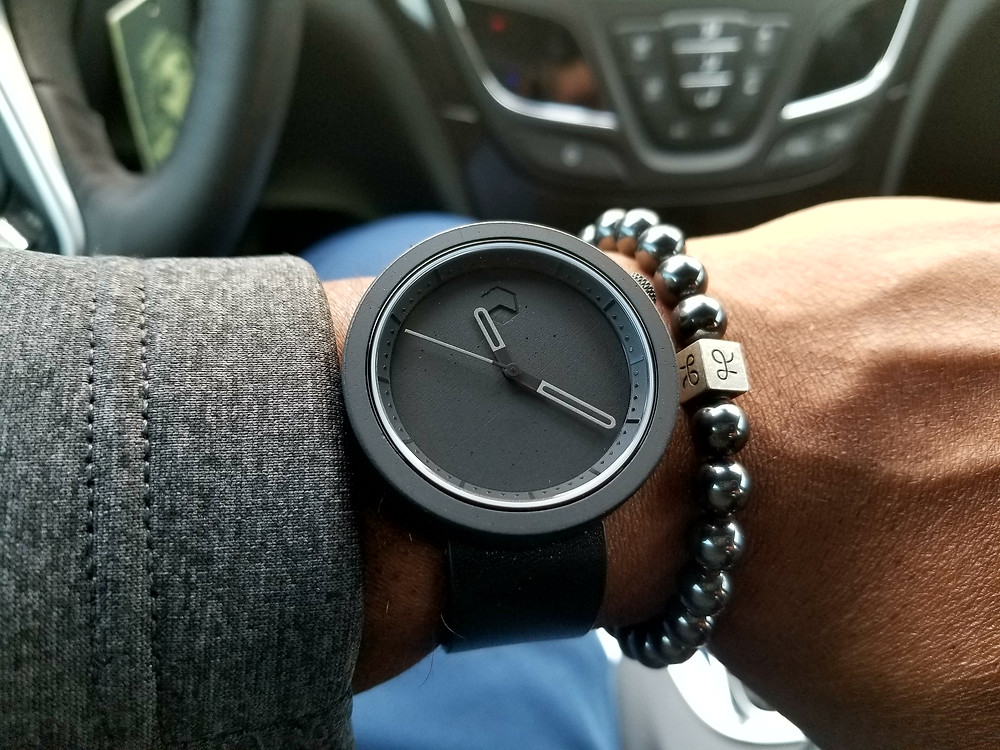 WOTD Wrist-Shot showing the Ag-Gre-Gate, Masonic, Black, paired with a set of Aurum Brothers minimalist hematite beaded bracelet.