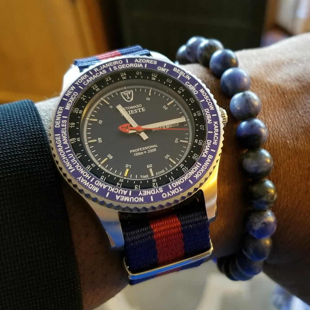 WOTD wrist-shot of the Detomaso, Trieste Globetrotter, paired with a minimalist, sodalite, beaded bracelet, designed by Aurum Brothers.