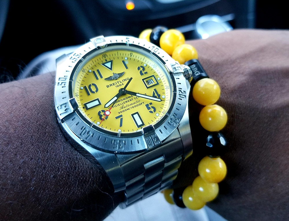WOTD Wrist-Shot showing the Breitling, Aeromarine, Avenger timepiece, accompanied by a custom beaded bracelet designed by Beads By Gonzo.