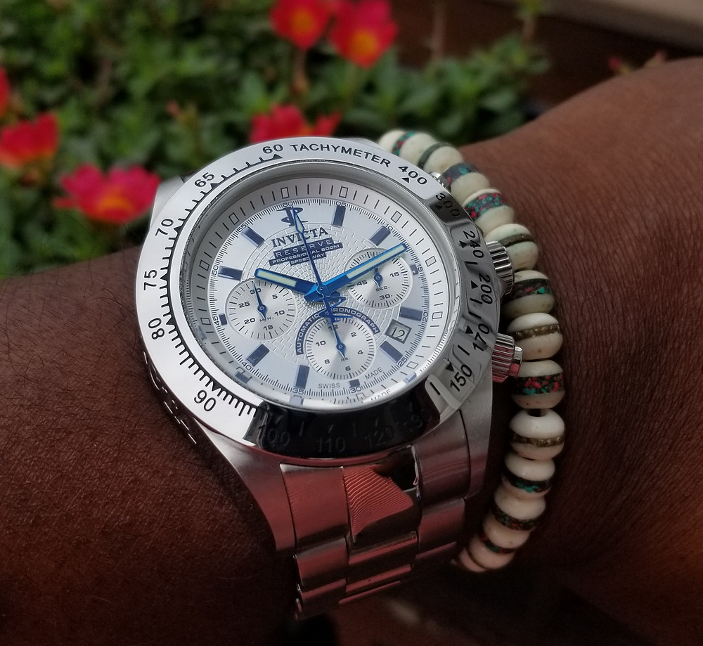 WOTD Wrist Shot of an Invicta, Dubois-Depraz, Speedway Chronograph, limited edition, paired with a yak bone, copper-infused, beaded bracelet.