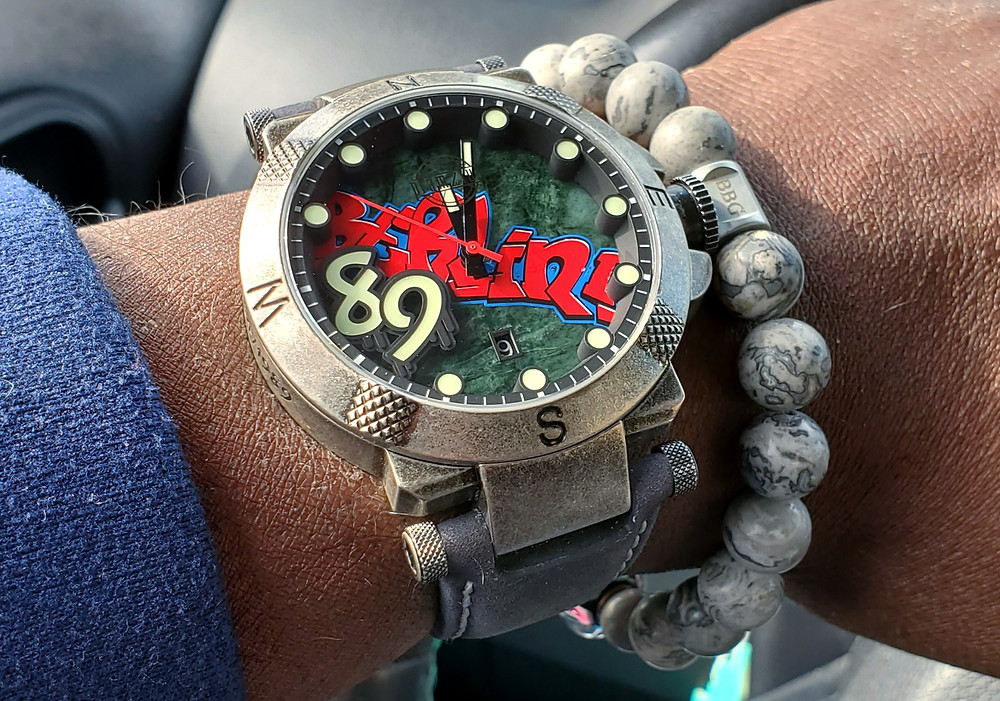 WOTD wrist-shot of the Pramzius, Fall of the Berlin Wall - Limited Edition.  Paired with a custom-crafted bracelet, designed by Beads By Gonzo.