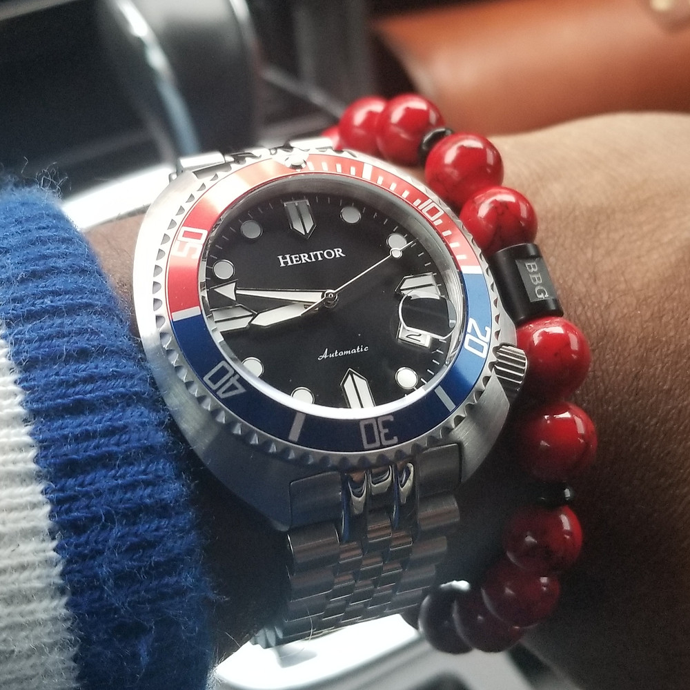 WOTD wrist-shot of the Heritor Morrison, Automatic, paired with a custom, beaded bracelet, designed by Beads By Gonzo.