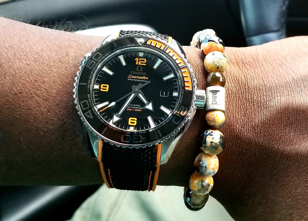 WOTD Wrist Shot of the Omega, Seamaster Professional, Planet Ocean accompanied by color-coordinated beaded bracelet by Beads by Gonzo.