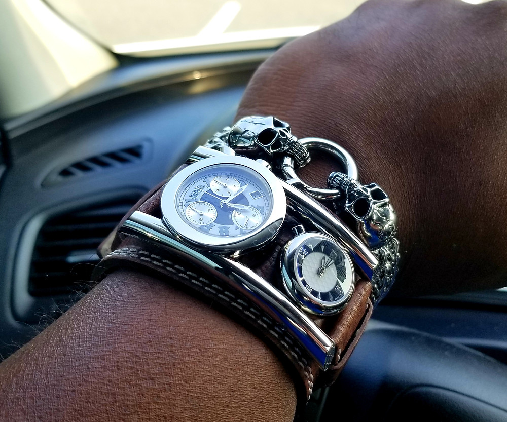 WOTD Wrist-Shot showing the Von Dutch, Dutchman, Dual-Time timepiece, paired with a Franco Linc, Street Skull, Curb Chain Bracelet.