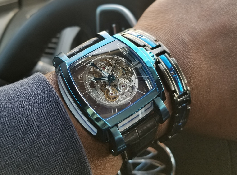 WOTD wrist shot of the Invicta, Sapphire Ghost, paired with an INOX flat bracelet, in matching electric blue.