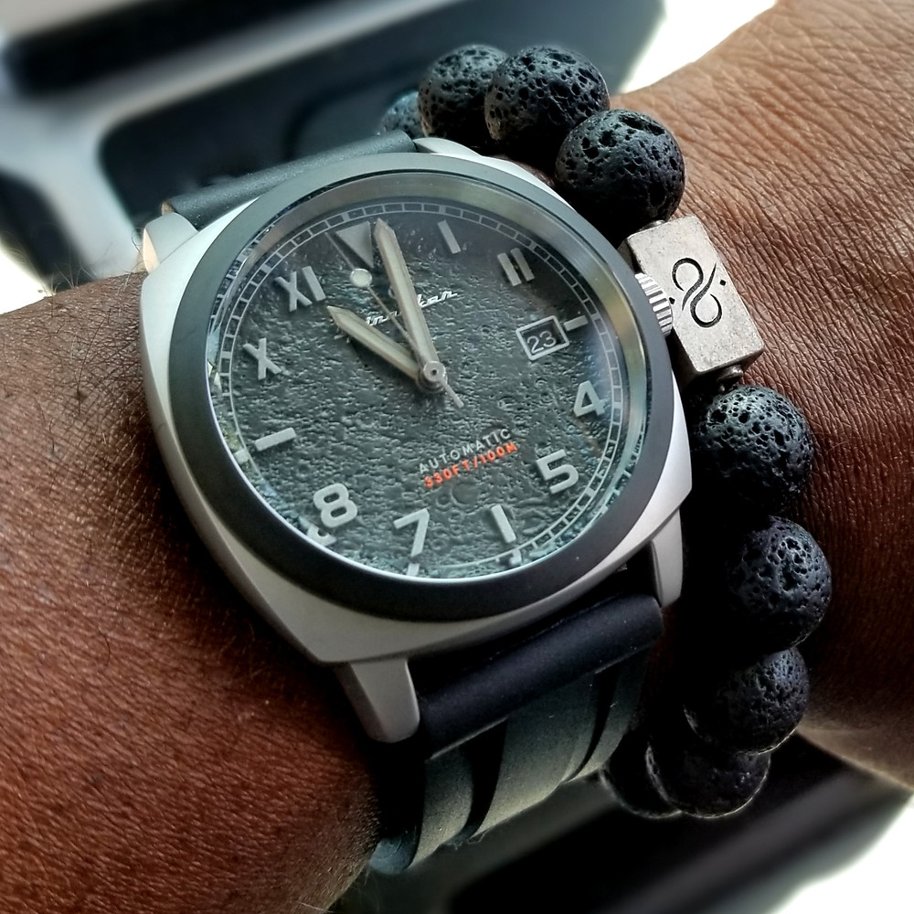 WOTD wrist-shot of the Zinvo, Blade Automatic, In Gunmetal.  Paired with a minimalist, Hematite stone beaded bracelet, designed by Aurum Brothers.