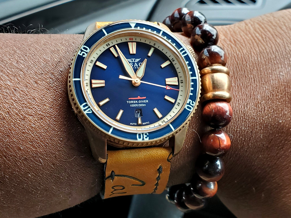 WOTD wrist-shot of the TSAO Baltimore, Torsk Diver - Bronze, Limited Edition.  Paired with a Tiger's-Eye, beaded bracelet.