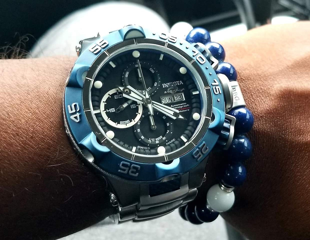 WOTD wrist shot of the Invicta, SubAqua Noma V, Automatic Chronograph, accompanied by custom Colts-themed beaded bracelet by Beads By Gonzo.