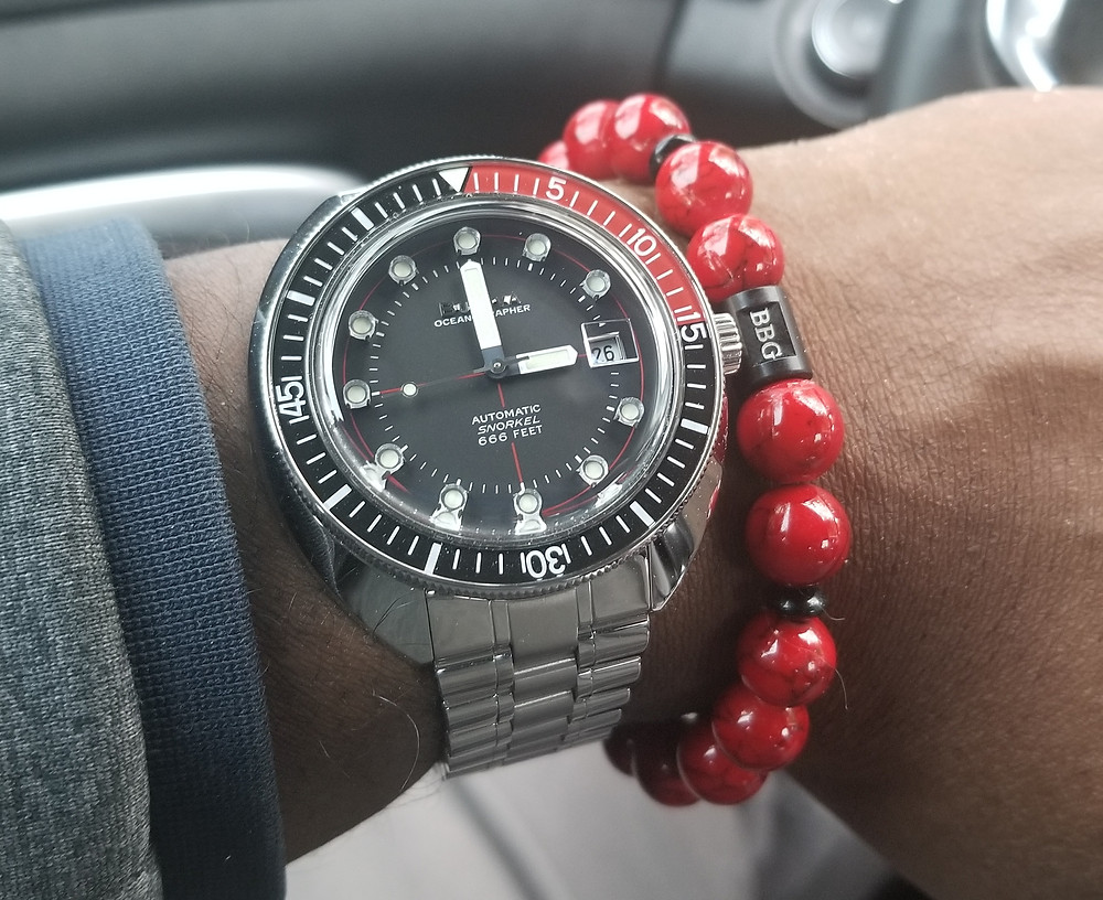 Wrist shot showing the re-issued Bulova, Oceanographer, Devil Diver 666, paired with custom-made, beaded bracelet, by Beads By Gonzo