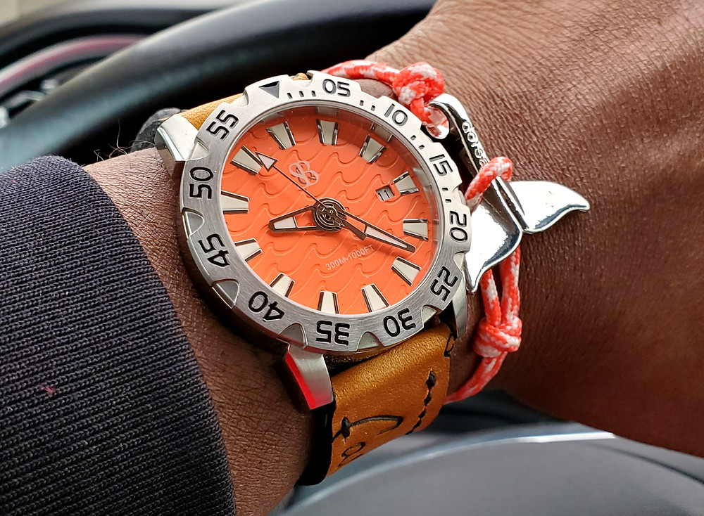 WOTD wrist-shot of the Smith & Bradley, Wraith Diver.  Accessorized with a whale tail, rope bracelet, designed by the Dorsal Bracelet Company.