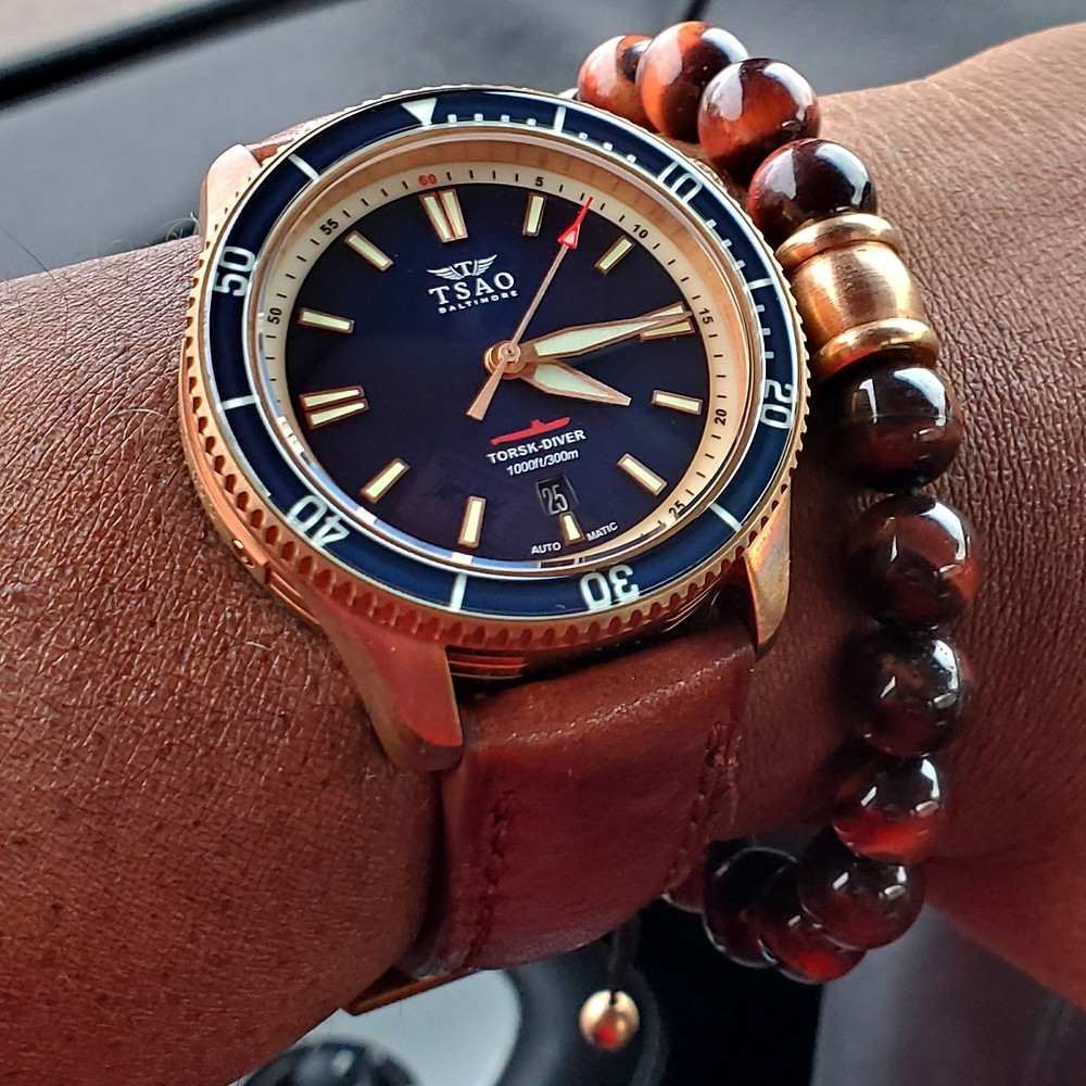 WOTD wrist-shot of the TSAO Baltimore, Torsk Diver, Limited Edition.  Paired with a Tiger's-Eye, beaded bracelet.