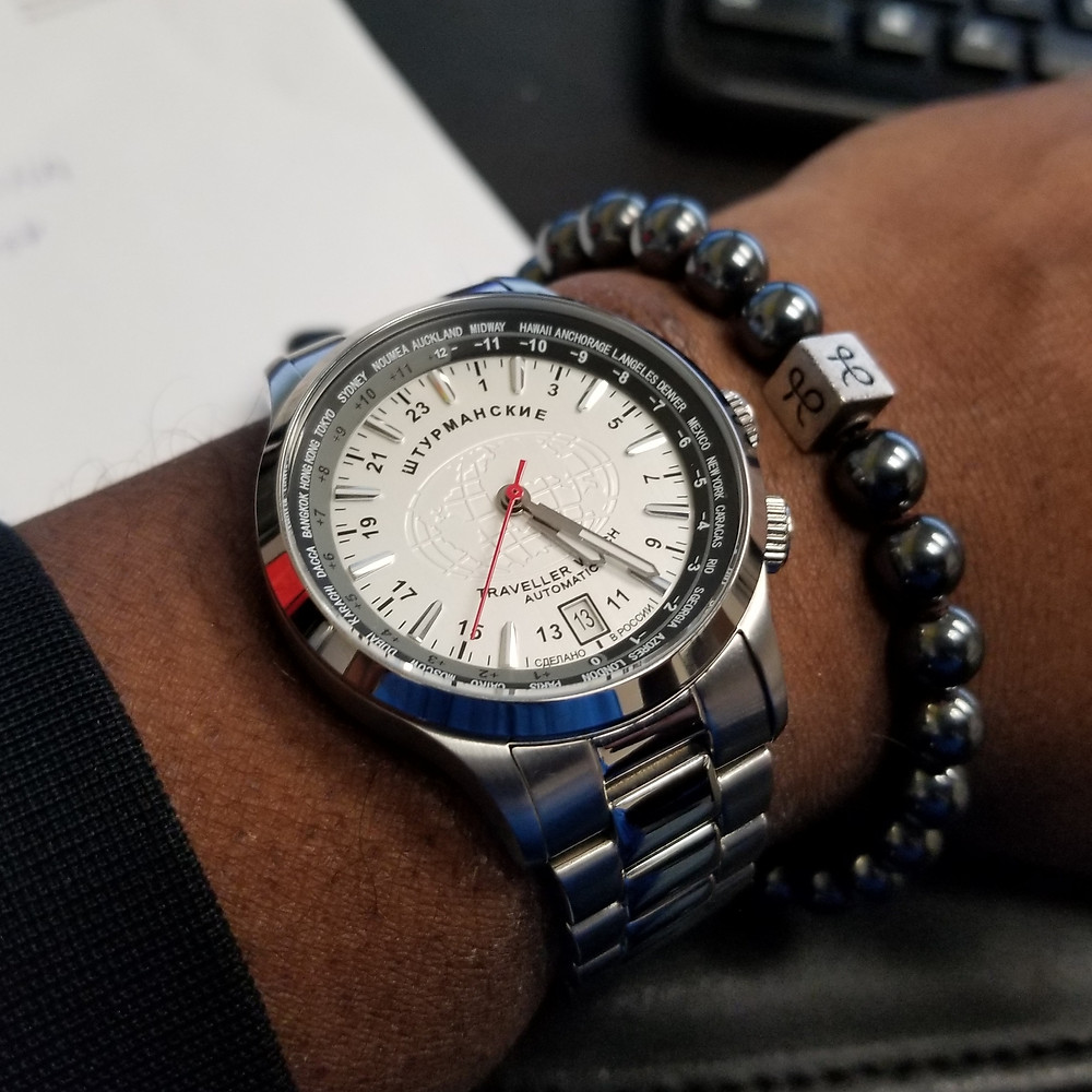 WOTD wrist-shot of the Sturmanski, Traveller Watch, Automatic, paired with a minimalist, Hematite beaded bracelet, designed by Aurum Brothers.