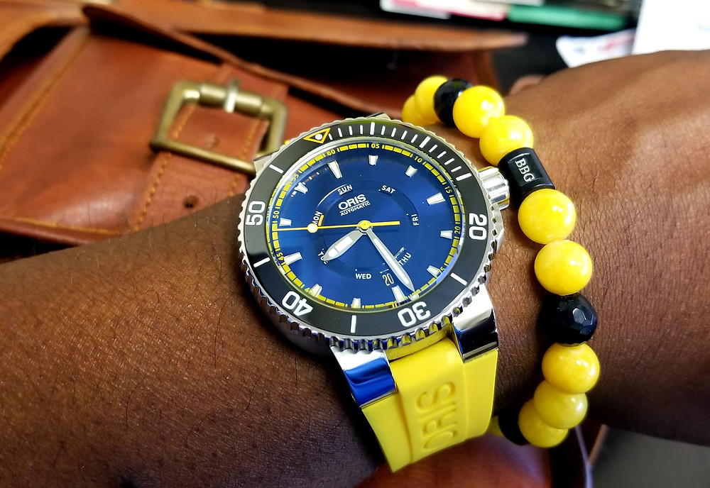 WOTD Wrist-Shot showing the Oris, Aquis, Great Barrier Reef Diver, Limited Edition timepiece, accompanied by custom-made beaded bracelet by Beads By Gonzo.
