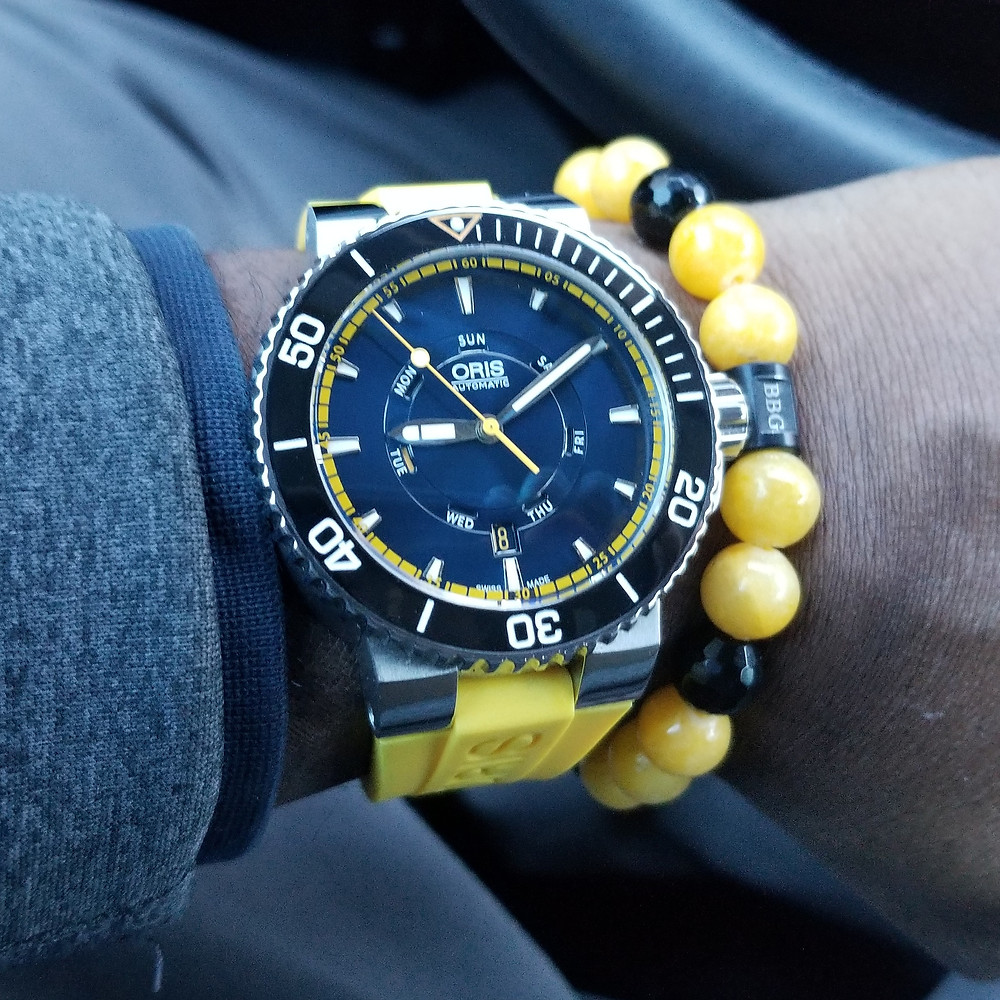 WOTD wrist-shot of the Oris, Aquis, Great Barrier Reef Diver, paired with a custom, beaded bracelet, designed by Beads By Gonzo.