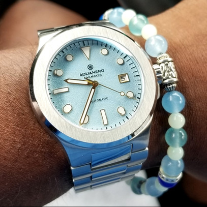 Wrist-shot of the Aquanero Sailmaker, paired with matching beaded bracelet.