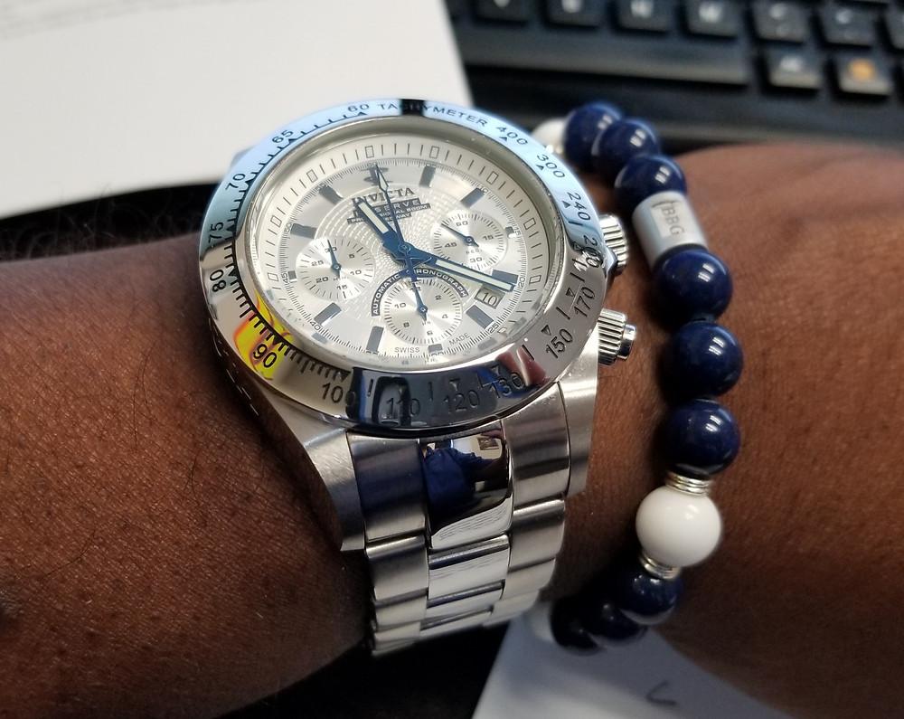 WOTD wrist shot of the Invicta Reserve, Dubois-Depraz, Speedway Automatic Chronograph, accompanied by custom Beads By Gonzo Beaded Bracelet.
