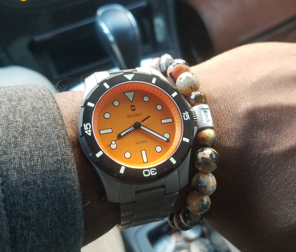 WOTD wrist-shot of the Helgray, TCD-01 Orange, Titanium Diver, accompanied by a custom beaded bracelet, designed by Beads By Gonzo.