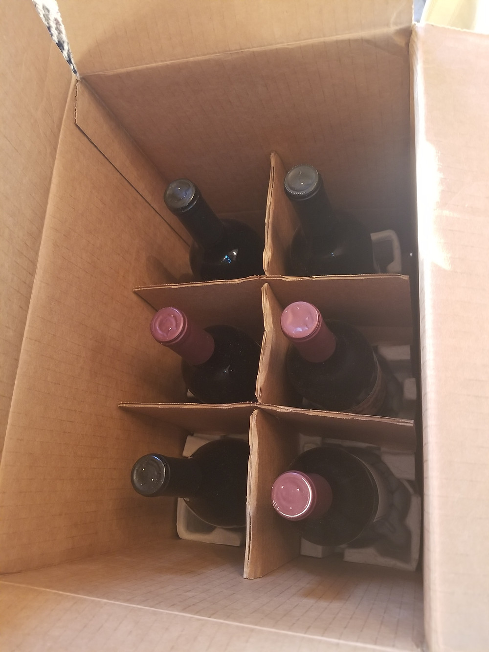 Assorted red wine, including Moscato, and red blends, from this month's FirstLeaf Wine Club delivery