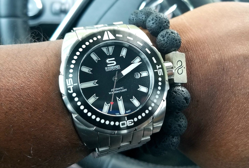WOTD wrist-shot of the Strider, Hyperdive timepiece, accessorized with a lava stone, beaded bracelet by Aurum Brothers