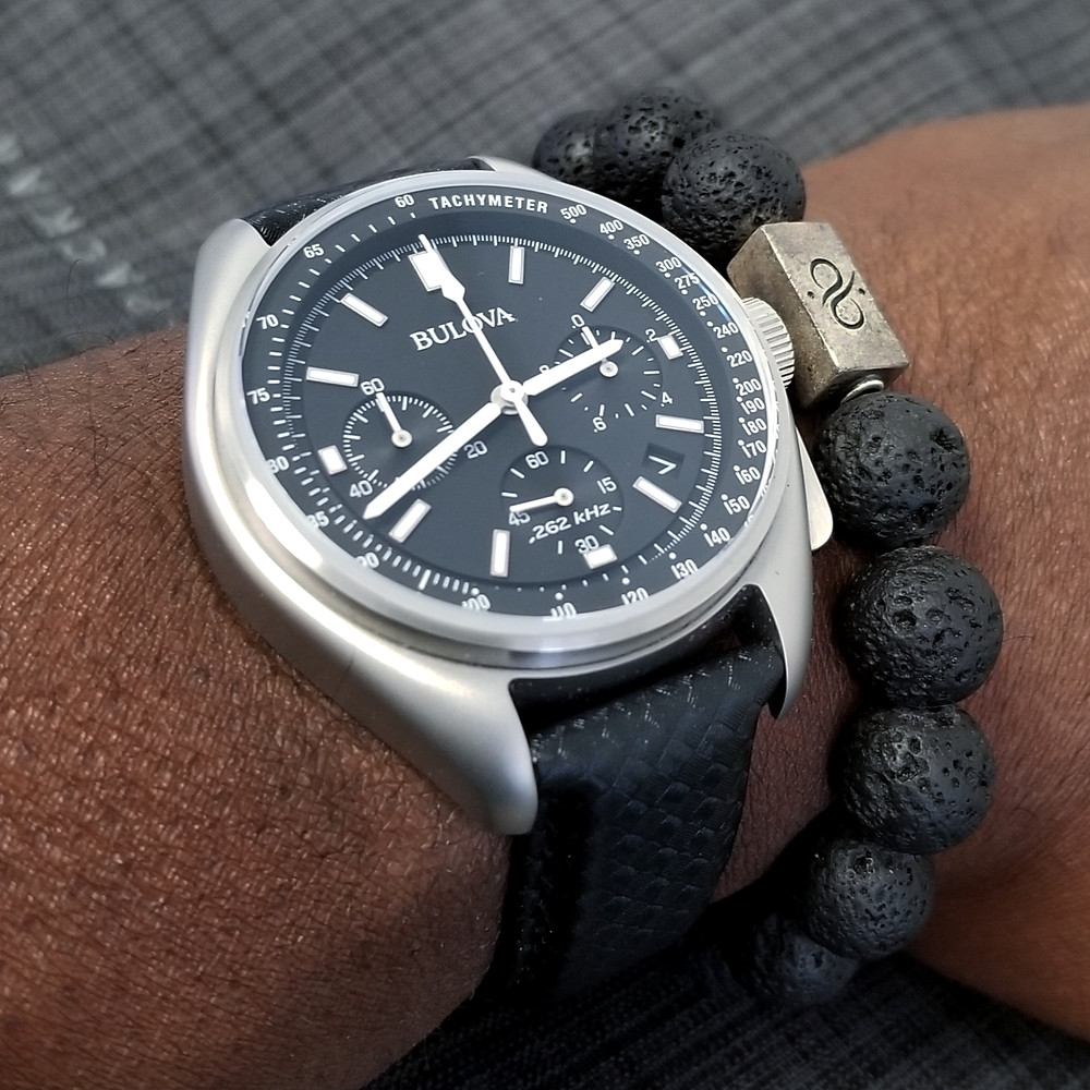 WOTD wrist-shot of Bulova, Lunar Pilot, Special Edition.  Paired with large-gauge, lava stone bracelet, designed by Aurum Brothers.