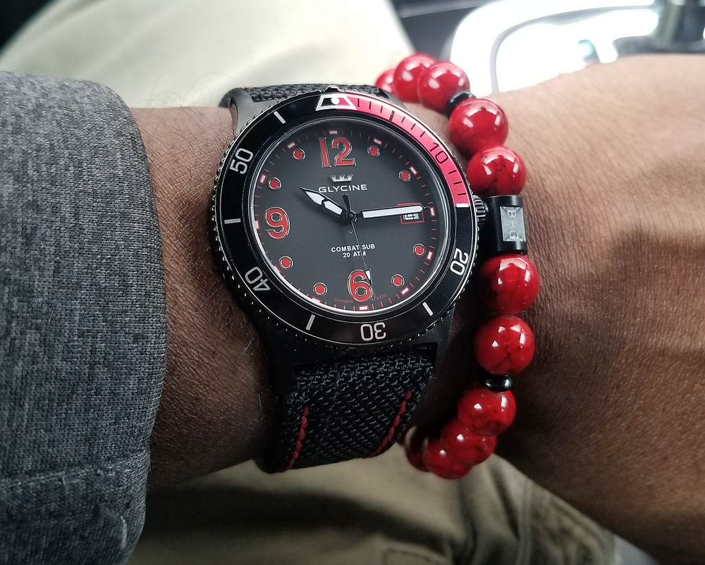 WOTD wrist-shot of the Glycine, Combat Sub,paired with a custom, beaded bracelet, designed by Beads By Gonzo.