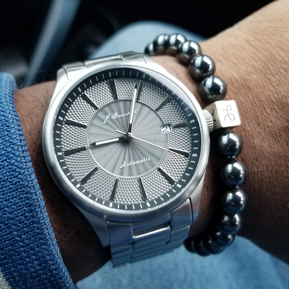 WOTD wrist-shot of the J. Brackett, Navigli, paired with a minimalist, Hematite, beaded bracelet, designed by Aurum Brothers.