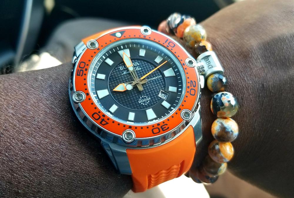 WOTD watch-u-wearing wrist-shot showing Bulova Marine Star and matching Beads by Gonzo beaded bracelet.