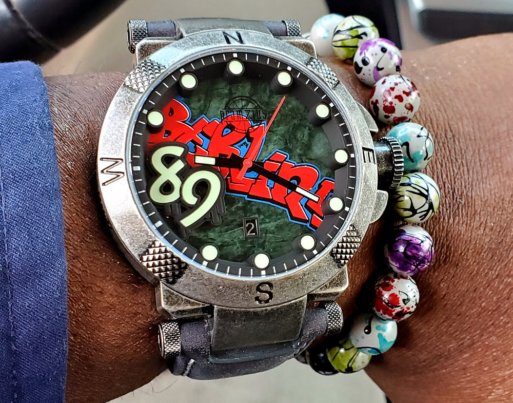 WOTD wrist-shot of the Pramzius, Berlin Wall Watch, Limited Edition.  Paired with custom, graffiti-splash, beaded bracelet.