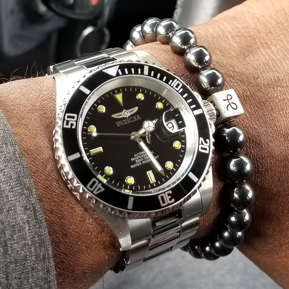WOTD Wrist Shot of the Invicta, Pro Diver 8926OB.  Accessorized with a set of minimalist, Hematite Stones, crafted by Aurum Brothers.