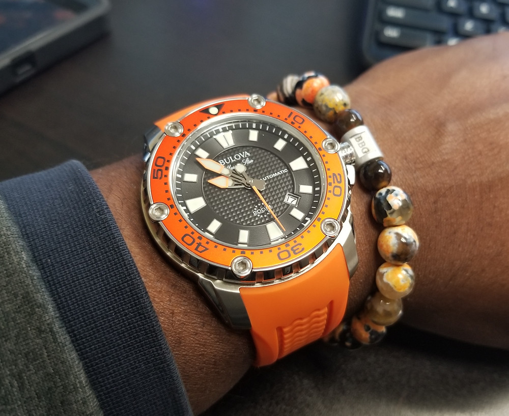 WOTD wrist shot of the Bulova, Marine Star, Automatic Dive Watch, accompanied with custom Beads By Gonzo beaded bracelet.