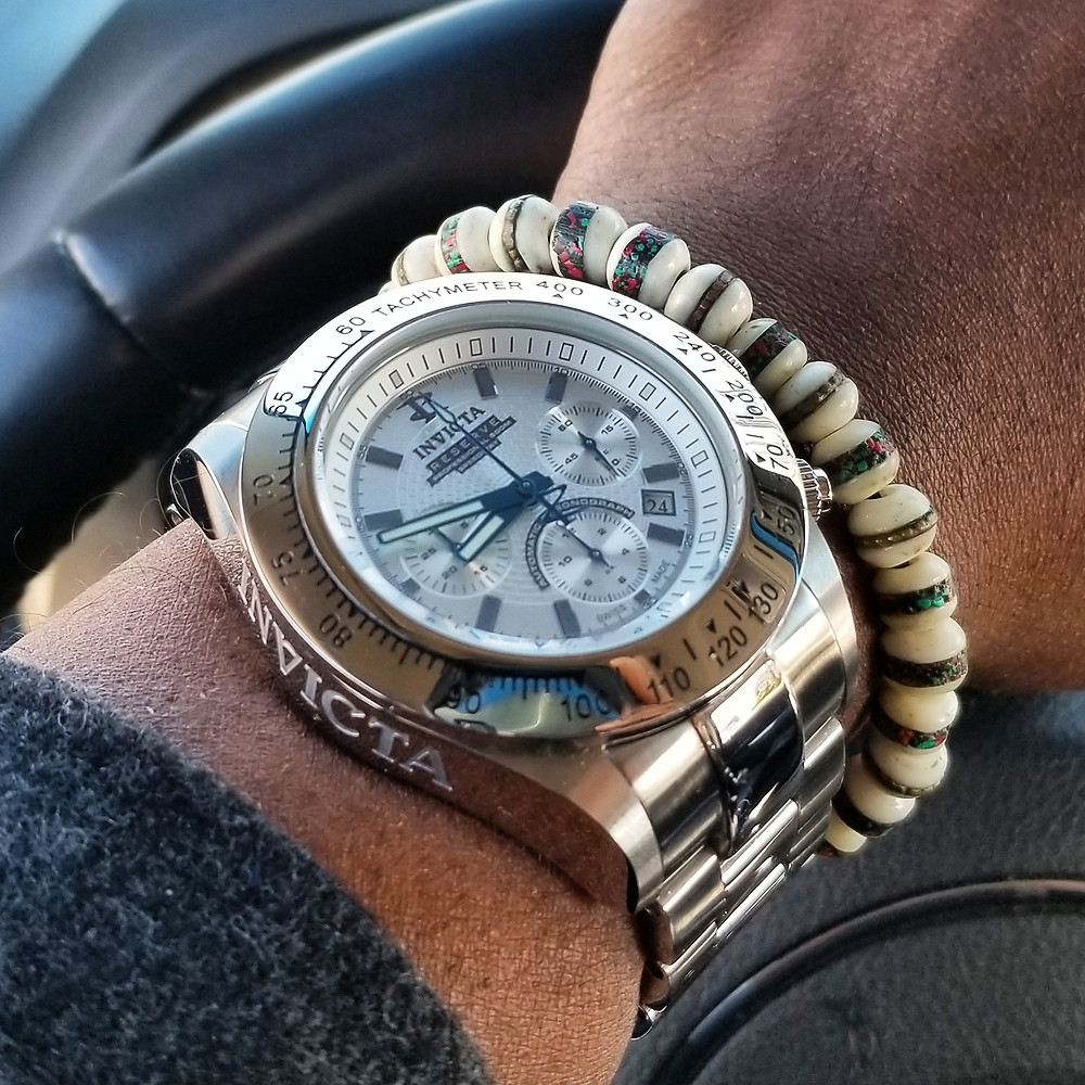 WOTD wrist-shot of the Invicta Reserve, Dubois-Depraz Swiss ETA Modified, Speedway Automatic Chronograph.   Paired with a Yak bone, copper-infused, beaded bracelet.