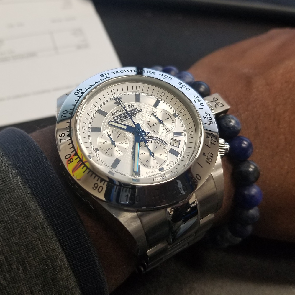 WOTD wrist-shot of the Invicta Reserve, Dubois-Depraz, Speedway Automatic Chronograph, paired with a minimalist, Sodalite, beaded bracelet, designed by Aurum Brothers.