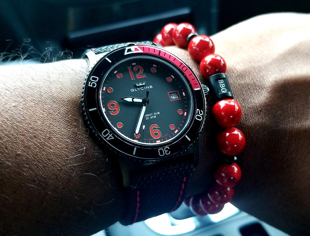WOTD wrist shot of the Glycine, Combat Sub, on contrast-stitched Kevlar strap, accessorized with custom beaded bracelet by Beads By Gonzo.